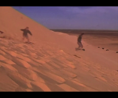 photo Sandboard le Snowboard sur sable